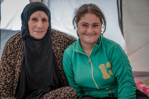 A mother and daughter in their tent at Badarash camp, Iraq