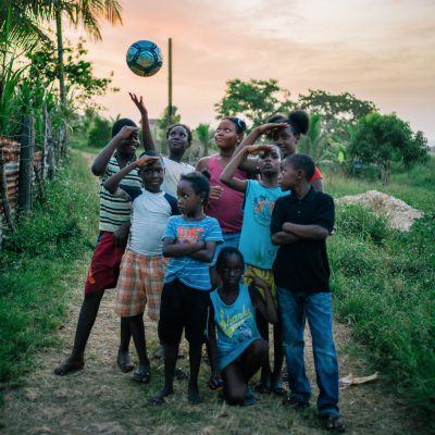 A group of children playing together in rural community in Jamaica
