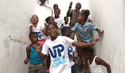 Photograph of children having fun and learning at the same time with Edusport, taught by Fight for Peace in Parade Gardens, Kingston.