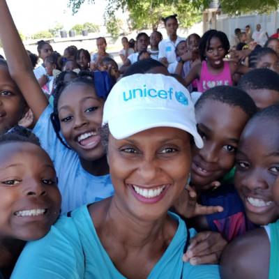 Photograph of UNICEF Jamaica Operations Manager Audrey Tulloch on Play Day 2018 with schoolchildren at a school in Kingston.
