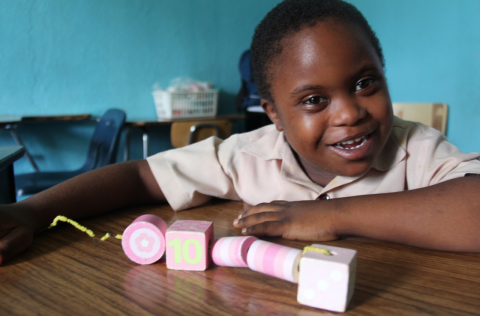 Photograph of a child who attends a special needs school in Jamaica