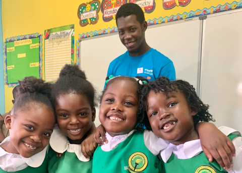 Photograph of UNICEF Jamaica team member Ajornie Simpson participating in Play Day at Mona Heights Primary School, St Andrew on February 5, 2020.