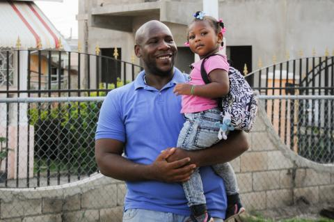 Photograph of a Father and daughter at Little World Early Childhood Development Centre in May Pen, Clarendon