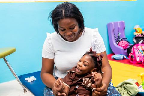 Photograph of a parent playing with her daughter at the Early Stimulation Plus school in Rockfort, eastern Kingston.