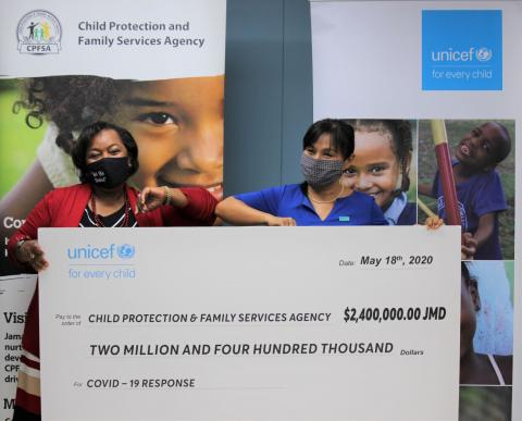 Rosalee Gage-Grey, CEO of the Child Protection and Family Services Agency (CPFSA), and Mariko Kagoshima, Country Representative of UNICEF at an official handover of JMD $2.4 million worth of sanitation and hygiene supplies to help protect nearly 1,700 children in 50 residential care facilities against COVID-19.
