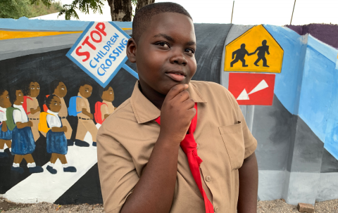 Photograph of a male student outside Hazard Primary School in Clarendon, Jamaica