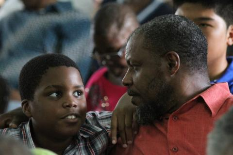 Photograph of Davy Nicholson, one of the parents who attended a cognitive testing workshop in Kingston, Jamaica in 2016, together with his son Zachary, aged 13, who has autism.