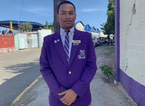 Photograph of Kingston College head boy, Chad Rattray, standing on the spot outside his school where he was robbed, an incident which inspired him to form Students Safety on the Streets Initiative (SOS).