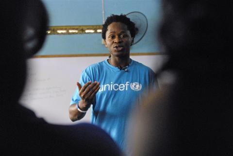 UNICEF Advocate for Children Affected by War Ishmael Beah speaks with young people at the project site of the UNICEF-supported NGO Children First, in Spanish Town in the parish of St. Catherine. Children First provides remedial education, skills training and other programmes for at-risk children.