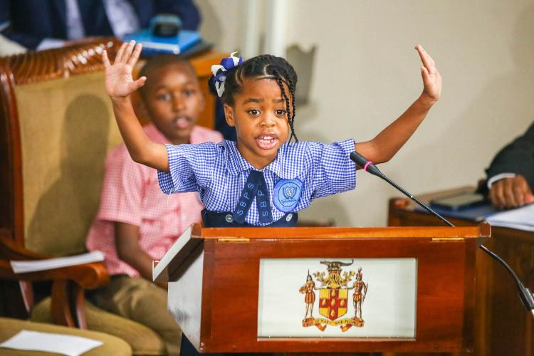 Photograph of Ngozi Wright, aged 7, addressing the Jamaican Parliament in a Special Session on Violence against Children on November 19, the eve of World Children's Day.