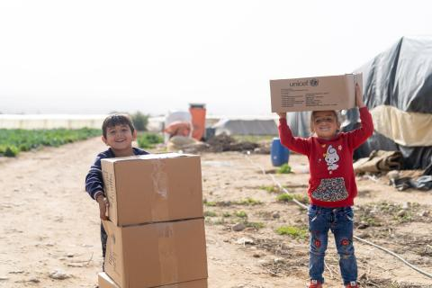 Two children with cardboard boxes