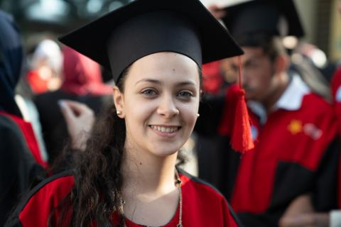A young woman in a graduation gown