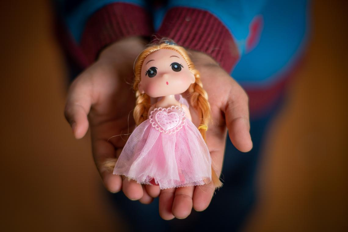 A doll in a girl's hands