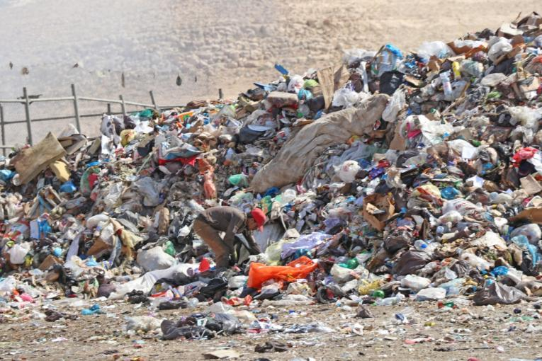 A child works on a landfill in Zarqa