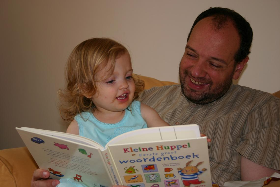 Arthur reading to his daughter Laura