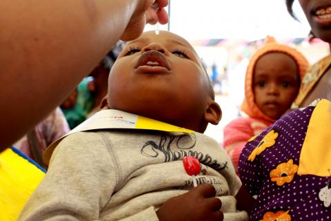 A child is given the polio vaccine