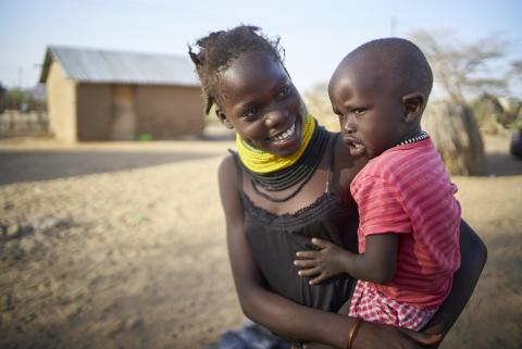 A Turkana girl sitting with her younger sister.