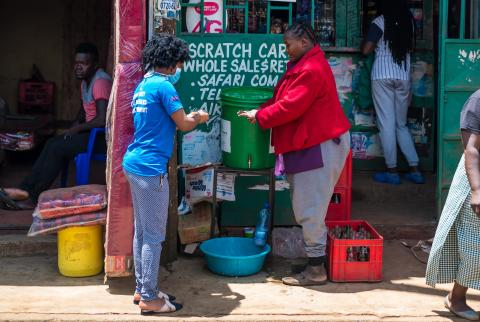 Vegetable stall holder learns how to wash her hands