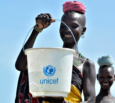 Elizabeth collects water from the UNICEF-provided solar powered water system
