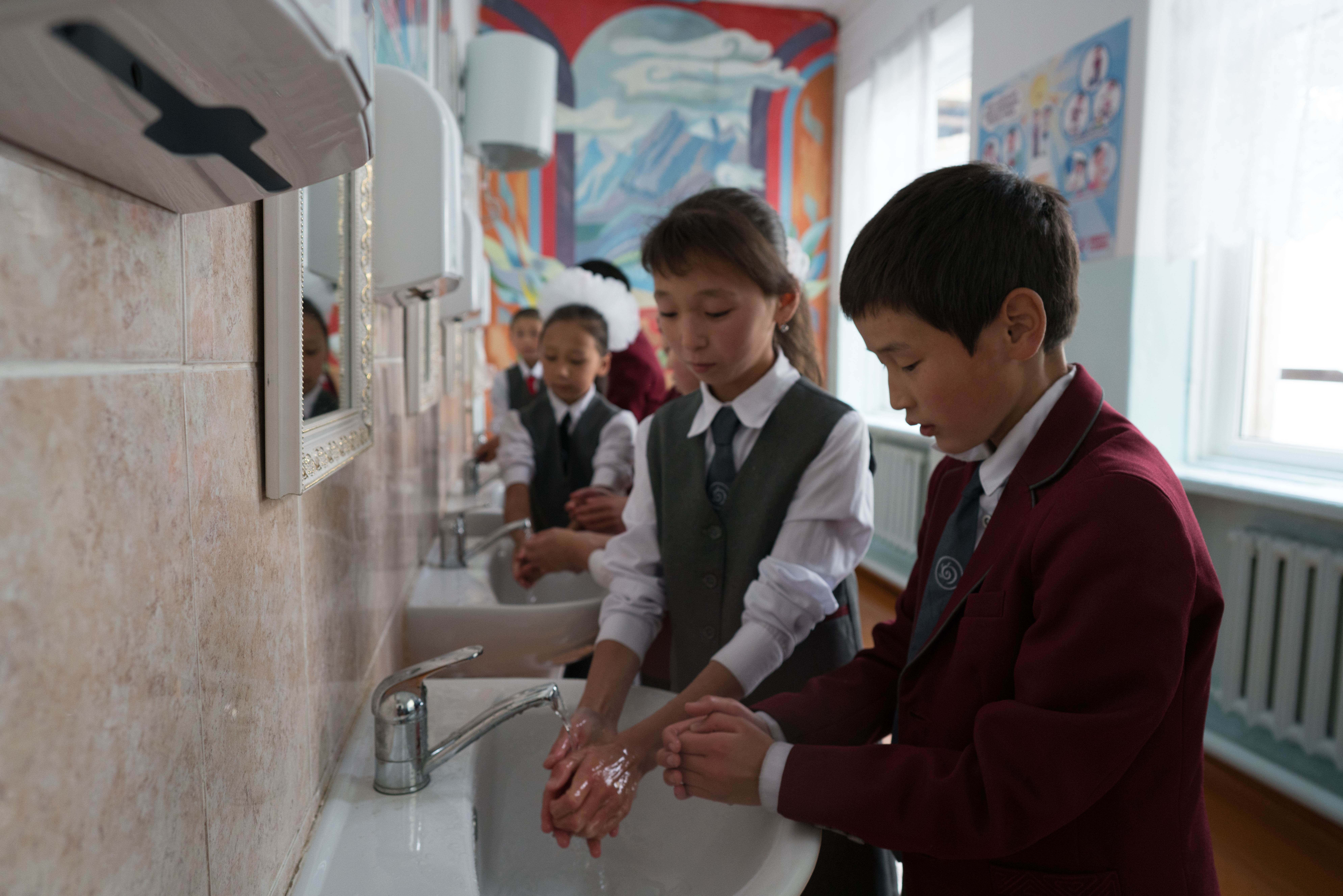 Children wash hands in Ak-Tuz school in Kyrgyzstan