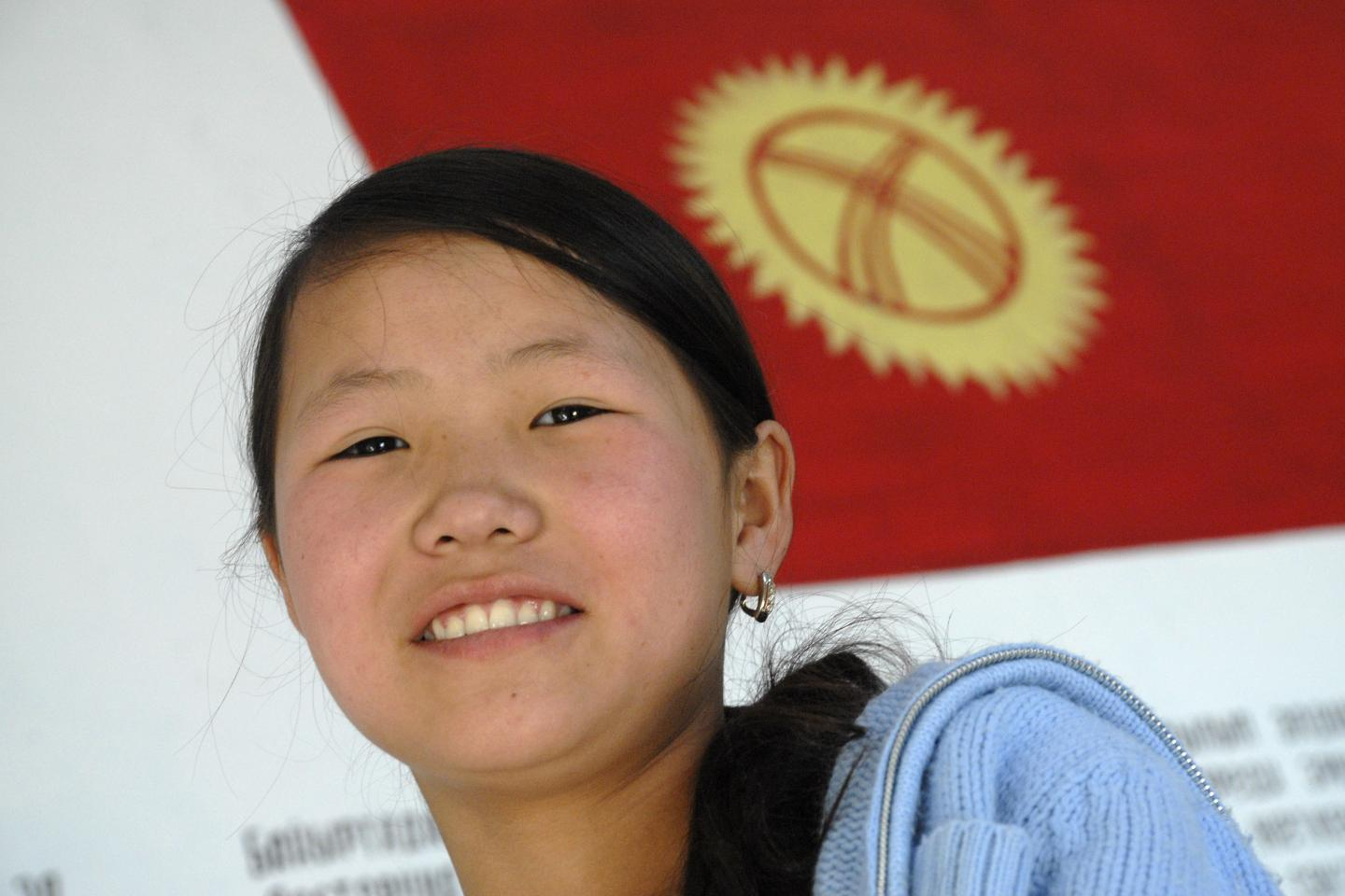 a girl with Kyrgyzstan flag