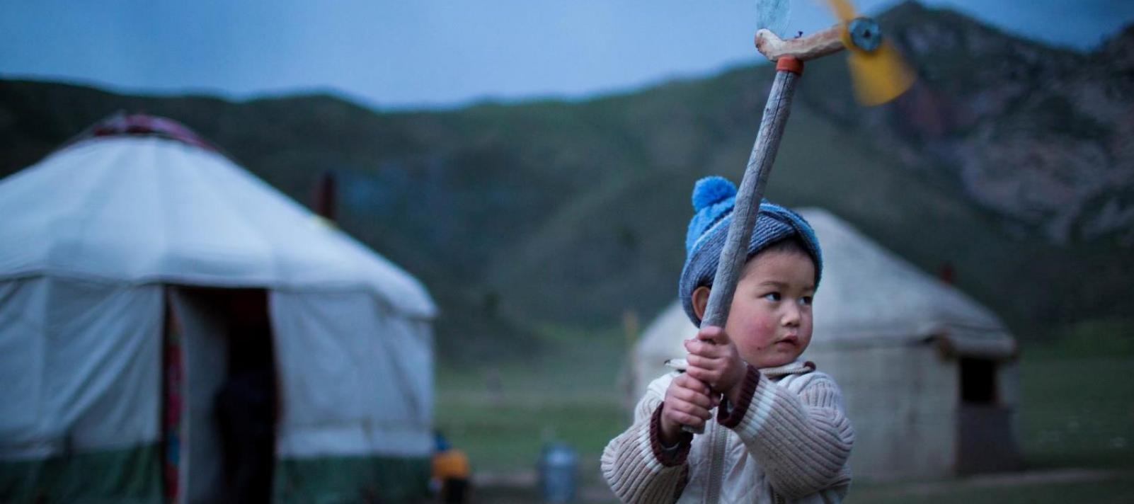 A boy plays in Naryn