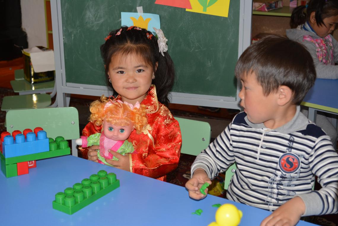 Malika plays with her friends in UNICEF-supported community-based kindergarten in the village of Yrdyk, Issyk-Kul province.