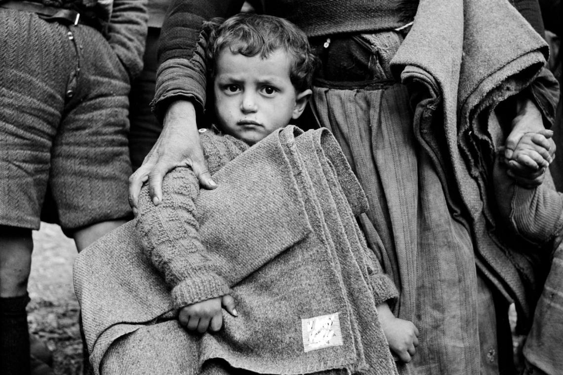 A boy holds UNICEF_supplied blanket in Greece