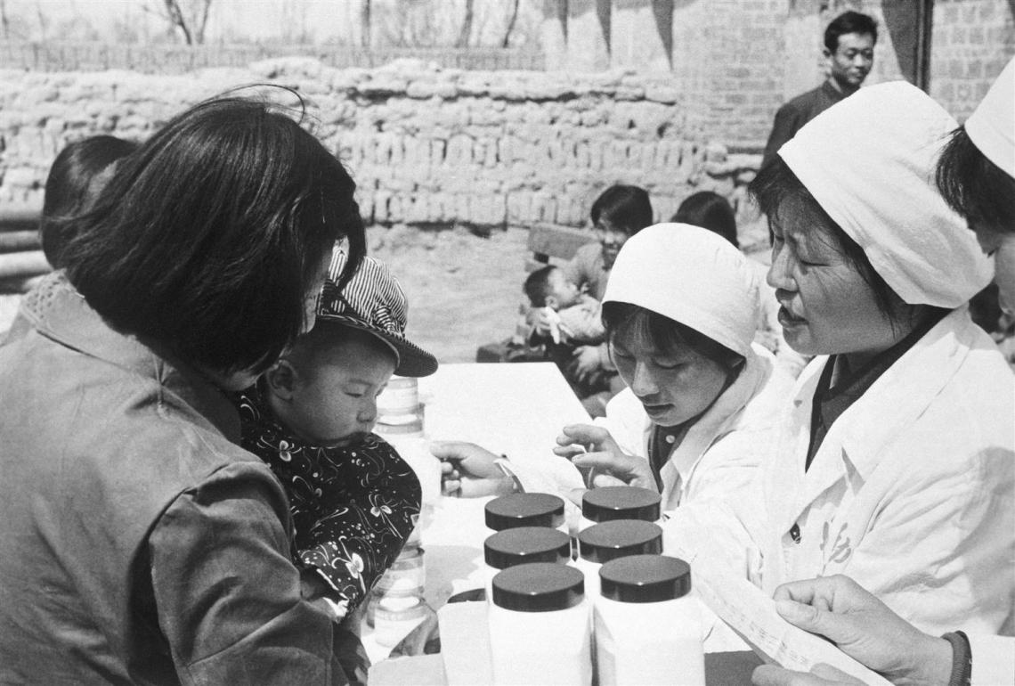 Women health workers in China distribute UNICEF-supplied vitamins