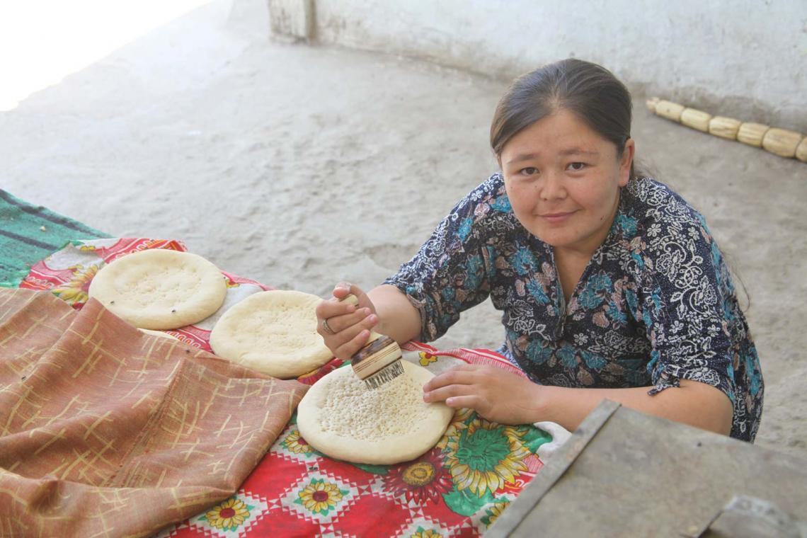 Tursunhan Salieva (39) prepares bread for her family living in Shark village, Kara-Suu District, Osh province (Kyrgyzstan). Families who live in poverty tend to have a diet low in nutrients, negatively affecting the health of the pregnant woman