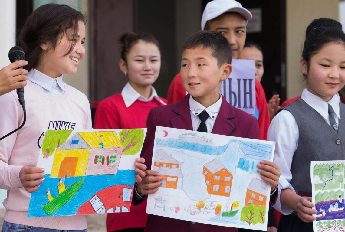 'Now we all know how to act, and who will save our lives if there is an earthquake', says 12-year-old Aida (far left), one of the drawing contest participants.