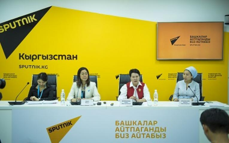 Panel of 4 women in front of bright yellow Sputnik graphic