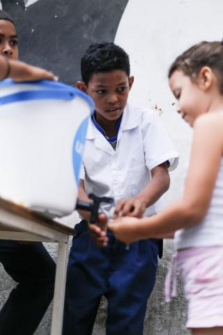 In the outskirts of Caracas, Wilker, 9, leads a hand-washing demonstration in La Ceiba Community, in Petare on June 4th 2019. Children show parents, families and other children in their neighborhood how to wash their hands to prevent bacteria and diseases