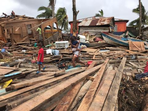 Mother and two children after the devastating path of Hurricane Iota in Bilwi, Puerto Cabezas, Nicaragua on 18 of November 2020.