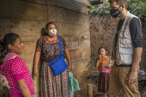Manuel Moreno, Regional Communications Specialist UNICEF LACRO, talks with Florinda Yatchub and her family living a temporary shelter in Sacsi Chitaña, in Alta Verapaz, Guatemala. On Dec. 2, 2020.