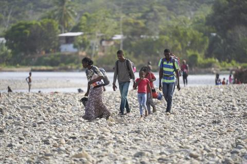 Janet (13 years old) and her family crossing the Tuquesa river towards Bajo Chiquito, the first panamanian village by the Colombian border, after a 7-day journey across the Darien Gap.