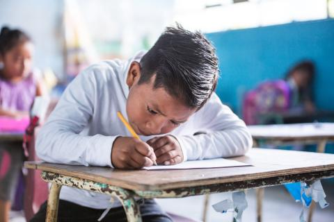 "A 10-year-old boy from the ""Escuela Los Laureles"" in Jalapa, Guatemala is completing a final year exam on science on October 23, 2019."