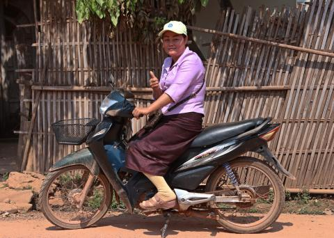 A woman in motorcycle