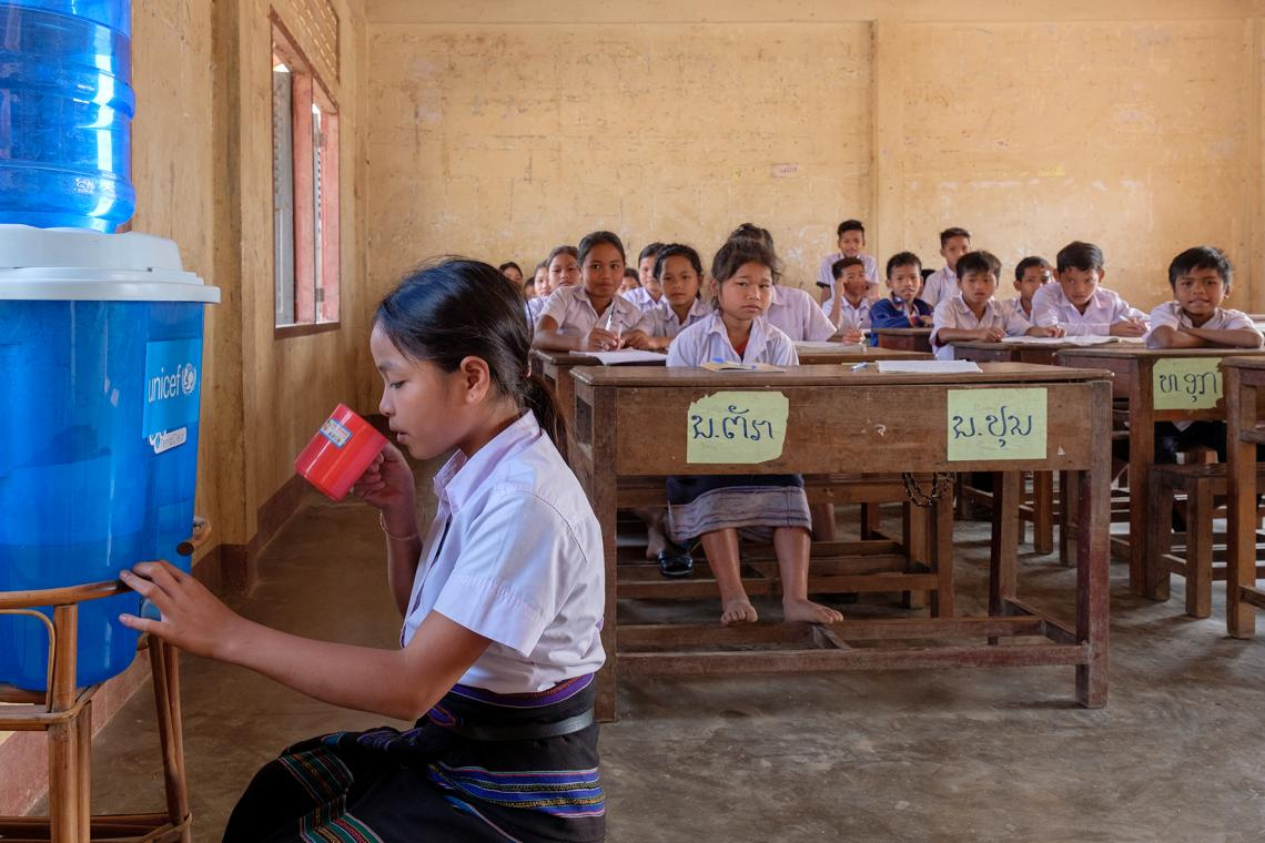11-year-old Poun drinking filtered water in her classroom at Doub primary school