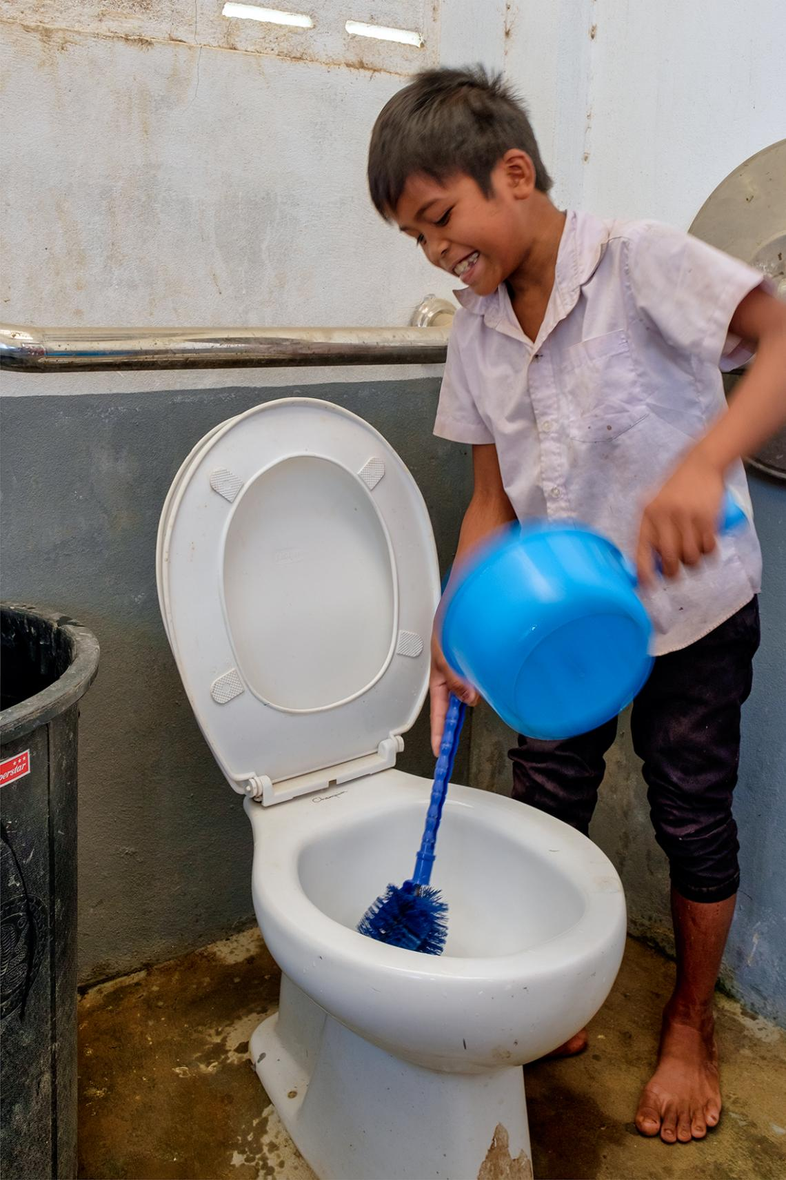 As part of Hygiene Actions led by Pupils in Schools (HAPiS) Toh is cleaning one of the toilets at his school.