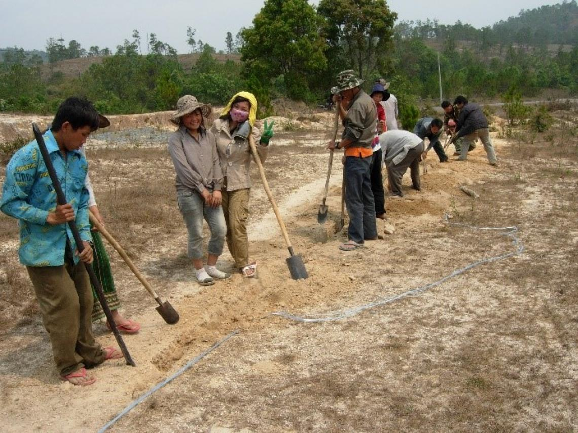 Community members digging a trench for water pipe laying in Xiengkhouang province