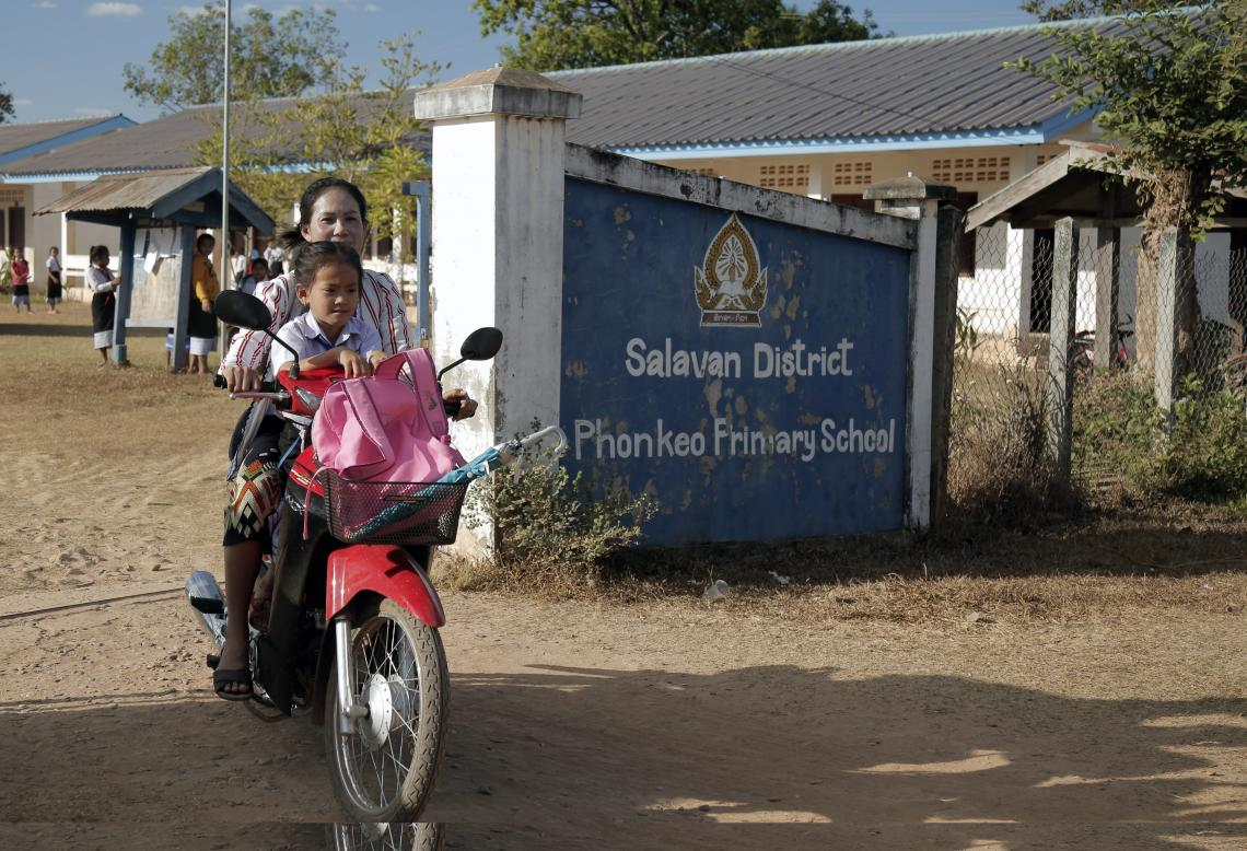 Titavanh and her mother heading home after school