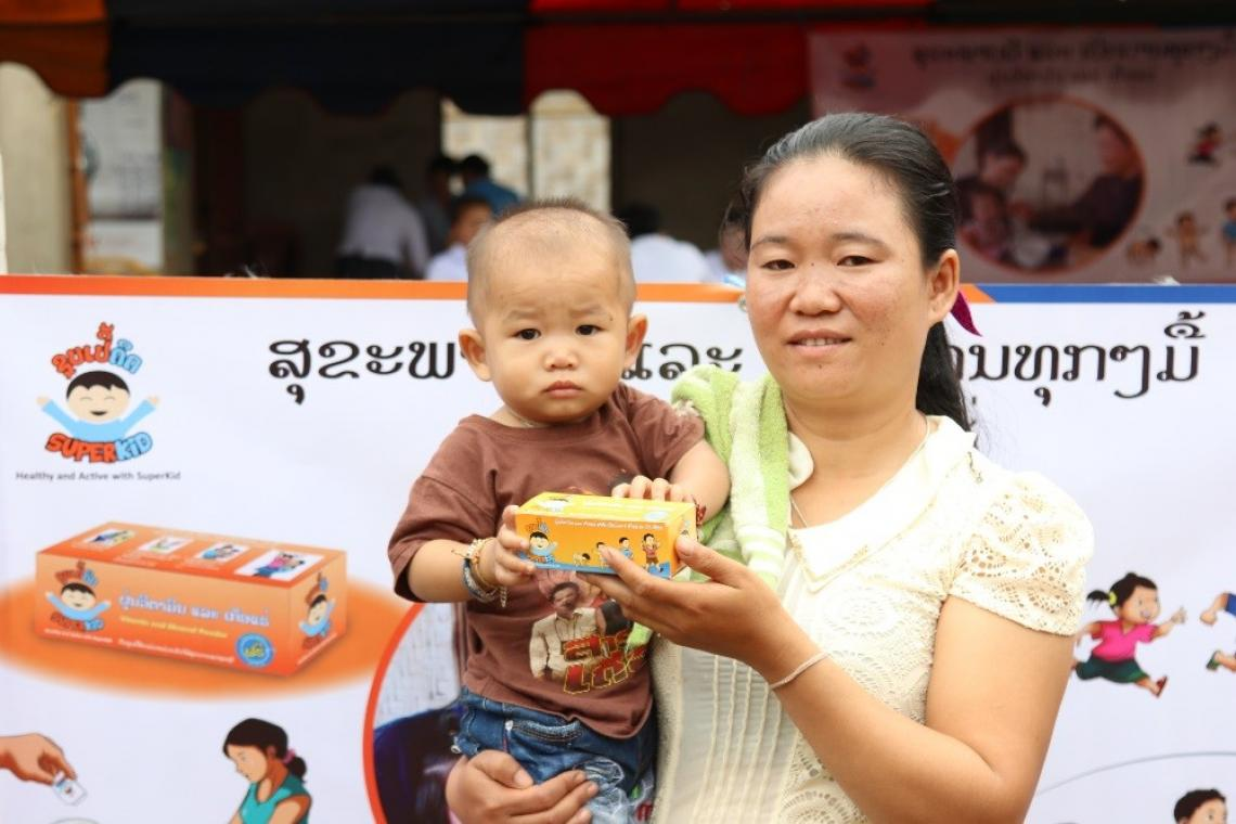 A mother and her son at a UNICEF-supported nutrition event
