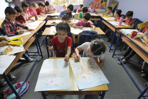 Children drawing in a classroom.