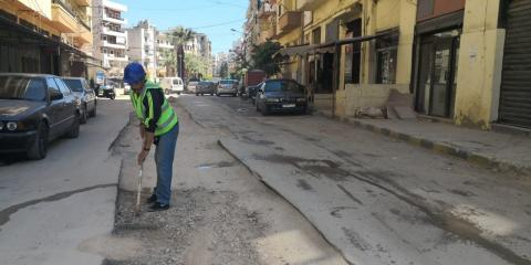 Bilal working in asphalt cutting