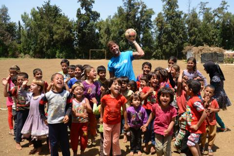 Ricky Martin with the kids in the refugee camp