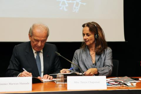 Minister Hamadeh and Tanya Chapuisat signing the Policy book