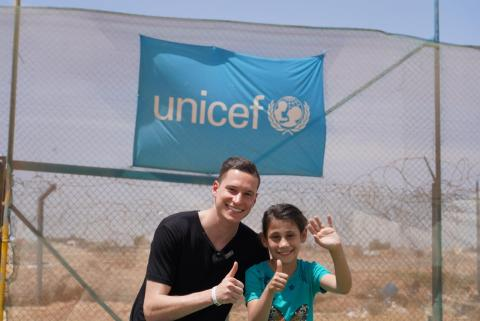 UNICEF staff with a child