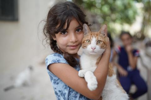 Fatme, 8 years holding a cat