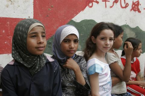 Girls sit outside the community centre at Chatila, a camp for Palestinian refugees in a suburb of Beirut, the capital.  In June 2005 in Lebanon, children represent almost one-third of the population. The Government has mandated free and compulsory education for all children up to age 15 and school enrolment has increased almost 40 per cent annually during the past five years. However, these significant achievements mask the struggles of public schools to meet demand.